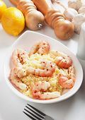 Delicious spicy asian shrimps served with cooked rice poster