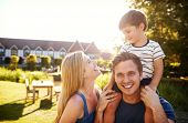 Portrait Of Family With Father Giving Son Ride On Shoulders In Garden Of Summer Pub poster