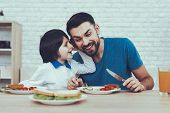 Delisious Food. Child On Chair. Happy Together. Man. Spends Time. Son. Father Of Boy. Engaged. Raisi poster