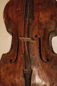 Wooden Antique Musical Instrument. A Wooden Musical Instrument Is Brown. poster