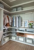 Wooden Wardrobe With Set Of Clothes poster