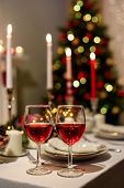 Served Holiday Table With Two Wine Glasses, Blurred New Year Decorations On The Background. Christma poster