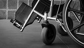 Closeup Foot Rest And Whee Of Wheelchair. Sad News At The Hospital. Depression With Aging Society. L poster