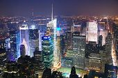 stock photo of new york night  - New York City Manhattan Times Square skyline aerial view panorama at night with skyscrapers and street - JPG