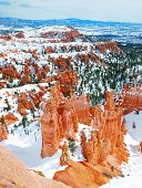 Bryce canyon panorama with snow in Winter with red rocks and blue sky.