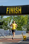 Triathlete crosses the finish line.