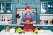 Man Chef Wear Apron Cooking In Kitchen. Man Cook Vegetarian Recipe With Fresh Vegetables. Vegetarian poster