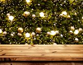 Christmas And New Year Background With Empty Wooden Deck Table Over Blurred Christmas Tree At Night. poster