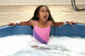 stock photo of hot-tub  - Young girl decides the hot tub is TOO hot - JPG