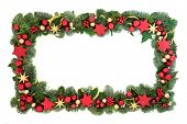 Decorative Christmas background border with red and gold star and ball bauble decorations with winte poster