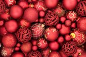 Red bauble christmas decorations forming an abstract background. Traditional christmas greeting card poster