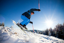 pic of winter sport  - Man practicing extreme ski on sunny day - JPG