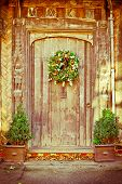 foto of english ivy  - A decorative traditional christmas wreath on an old door - JPG