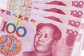 stock photo of yuan  - Chinese 100 RMB or Yuan featuring Chairman Mao on the front of each bill - JPG