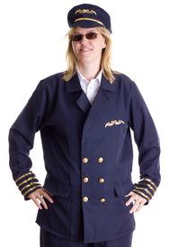 stock photo of stewardship  - Female pilot standing firm in her job - JPG