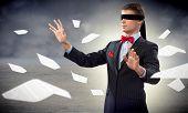 foto of blindfolded man  - young blindfolded man - JPG