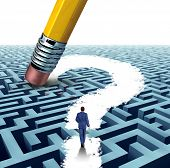 stock photo of pencil eraser  - Leadership questions searching for solutions with a businessman walking through a complicated maze opened up by a pencil eraser question mark as a business concept of innovative thinking financial success - JPG