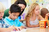 foto of tutor  - Group Of Elementary Age Children In Art Class With Teacher - JPG