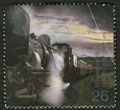 UK - CIRCA 2000: A stamp printed in UK shows image of the Garratt Steam Locomotive No. 143 pulling T