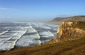 image of mile  - Lines of surf roll in to Rhossili Beach  - JPG