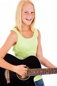 laughing pre teen girl playing a guitar over white background