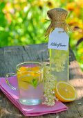 picture of elderflower  - elderflower juice on wooden table and natural background