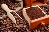 stock photo of wooden box from coffee mill  - coffee beans and powder with wooden scoop - JPG