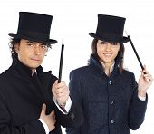 stock photo of magic-wand  - Attractive couple with a magic wand and hat on a over white background - JPG