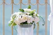 picture of beachfront  - Wedding decoration white bouquet near the beachfront - JPG