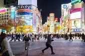 TOKYO - DECEMBER 10: Pedestrians cross at Shibuya Crossing on December 10, 2013 in Tokyo, Japan. The