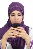 pic of arabic woman  - Arab woman writing a message addicted to the smart phone isolated in a white background - JPG