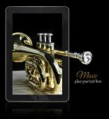 image of aerophone  - Online music with golden trumpet on black with copy - JPG