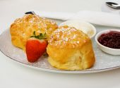 foto of devonshire  - Delicious fresh devonshire scones served with strawberry jam and cream - JPG