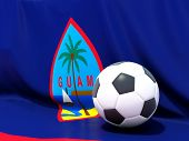 stock photo of guam  - Flag of guam with football in front of it - JPG