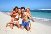 foto of four  - Family of four having fun at the beach - JPG