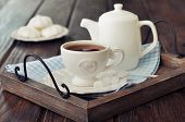 stock photo of teapot  - Cup of tea and teapot on wooden tray closeup - JPG