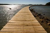 Wooden Walkway Leading Into The  Horizon