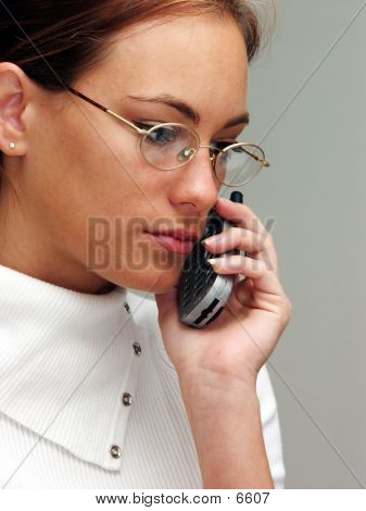 Picture or Photo of Young woman talking on a cellphone