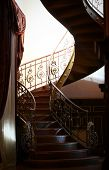 stock photo of spiral staircase  - Vertical color shot of a vintage spiral staircase - JPG