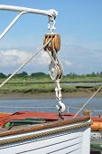 picture of pulley  - Life boat bow with large pulley holding it up