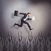 stock photo of cunning  - Business man running over heads of other businessmen - JPG