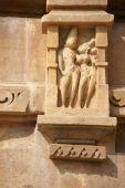 foto of kandariya mahadeva temple  - Sculptures of loving couples illustrating the Kama Sutra on walls of Kandariya Mahadeva Temple at Khajuraho in India Asia - JPG