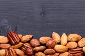 foto of pecan nut  - Background texture of assorted mixed nuts including cashew nuts - JPG