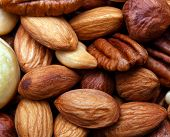stock photo of pecan  - Background texture of assorted mixed nuts including cashew nuts - JPG