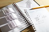 image of applique  - Applique paper with building and solar panels in notebook - JPG