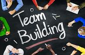 picture of team building  - Multiethnic People Discussing About Team Building - JPG