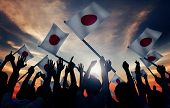 image of japanese flag  - Group of People Waving Japanese Flags in Back Lit - JPG