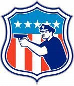 stock photo of policeman  - Illustration of a policeman police officer pointing shooting gun facing side set inside shield crest with american stars and stripes flag in the background done in retro style - JPG