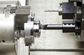 picture of manufacturing  - shaft detail turning on metal cutting machine tool at manufacturing factory - JPG
