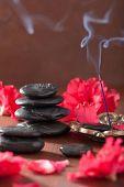 stock photo of azalea  - azalea flowers black massage stones incense sticks for aromatherapy spa - JPG